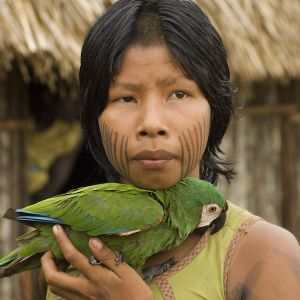 Girl with parrot by cristina mittermeier