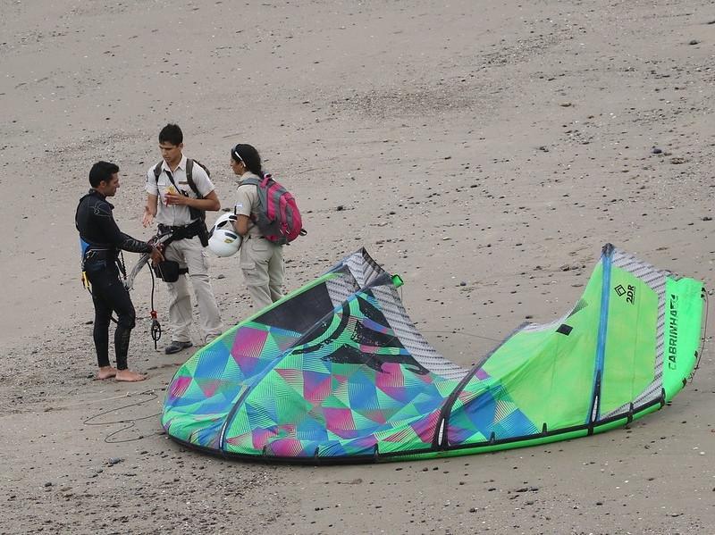 Rangers talk with kite surfer (photo: Scott Hecker)
