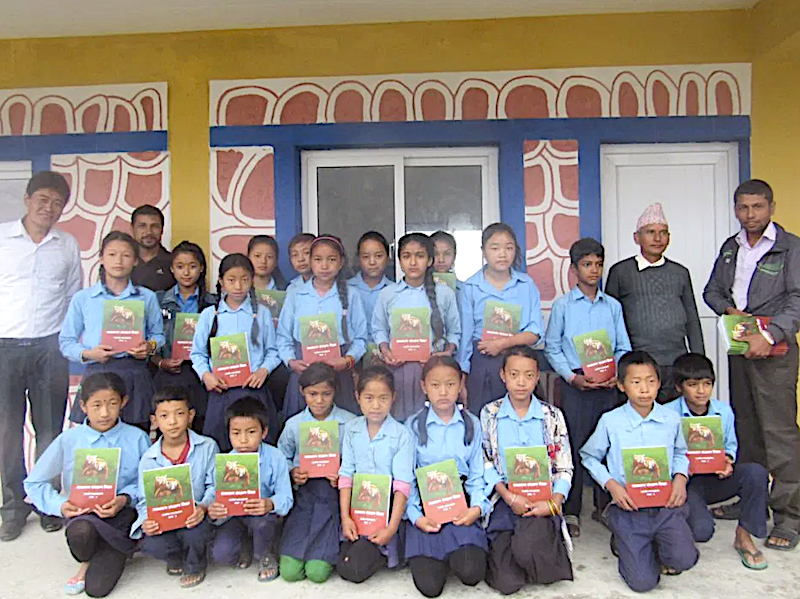 School children with red panda conservation manual